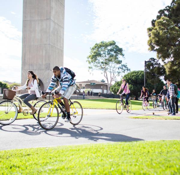 UCSB students riding bikes on campus